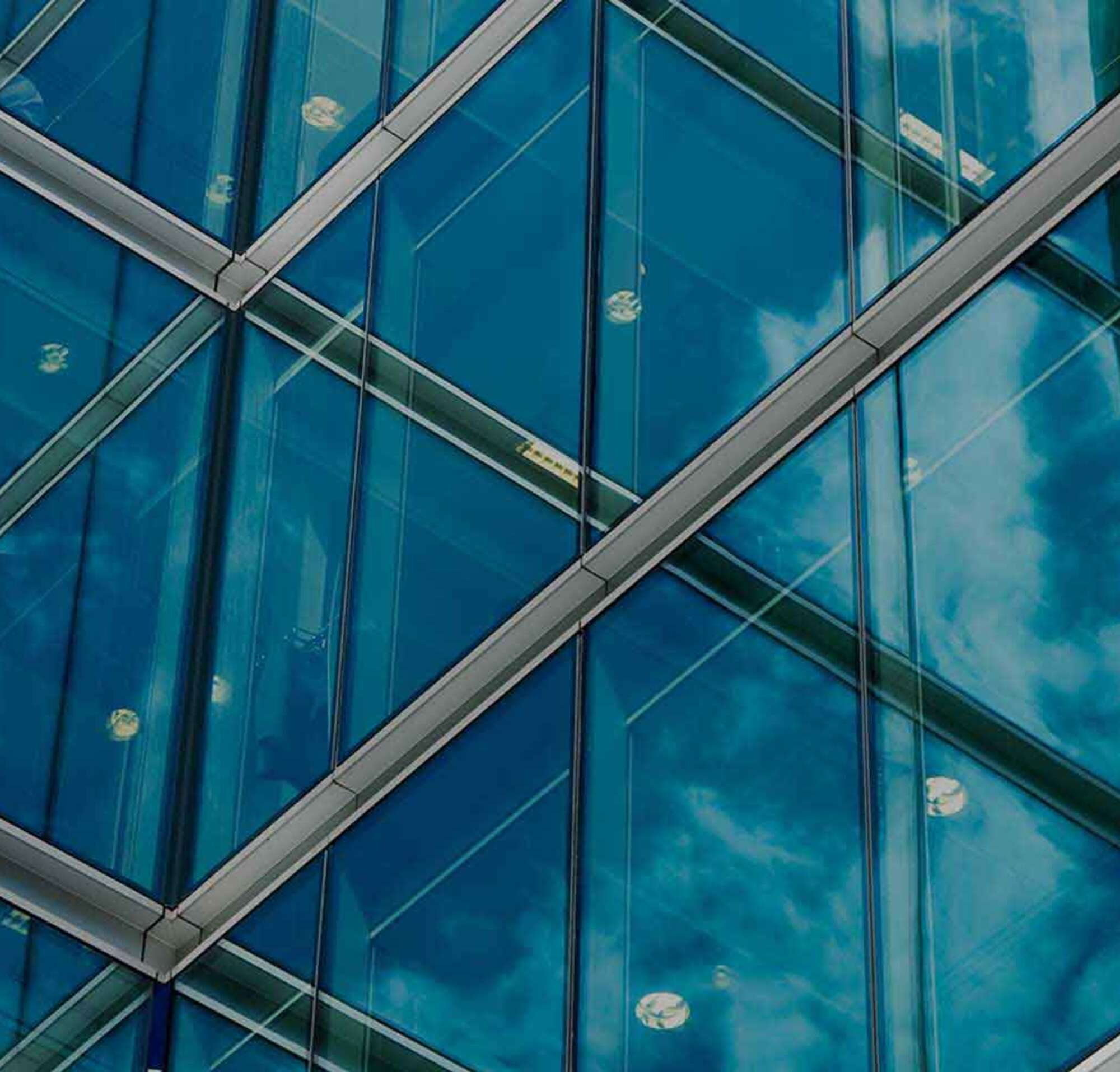 Glass windowed building with text introducing DocuSign products, integrations and APIs.
