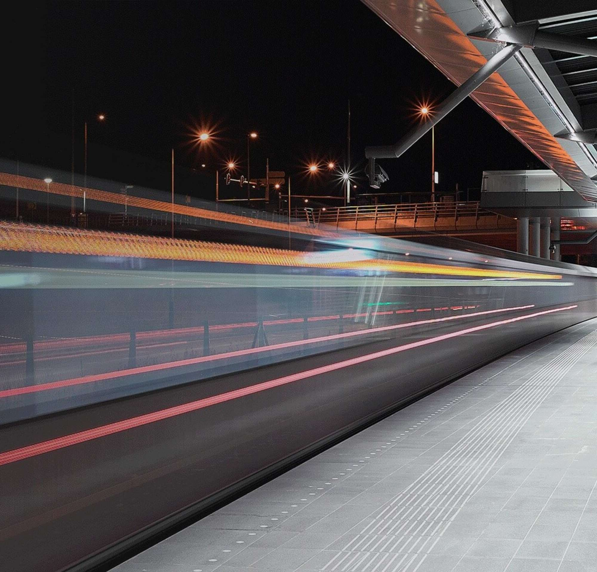 A train moving at high speed through a train station.
